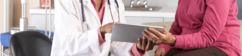 doctor showing patient EHR tablet