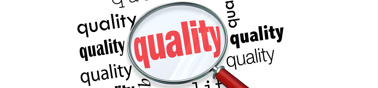 Magnifying glass on the word quality